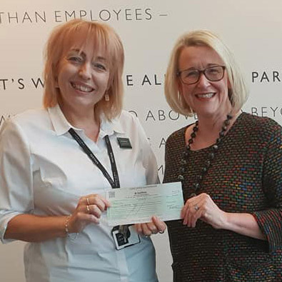 Debbie Fullbrook presents the cheque to Jenny Chambers