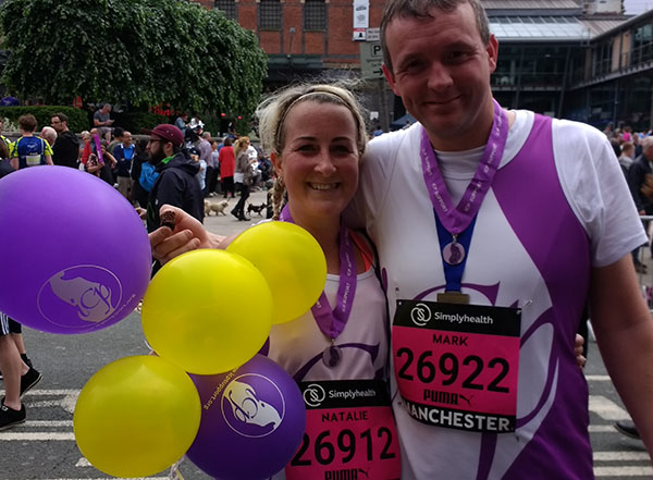 Natalie and Mark at the finish with ICP Support balloons